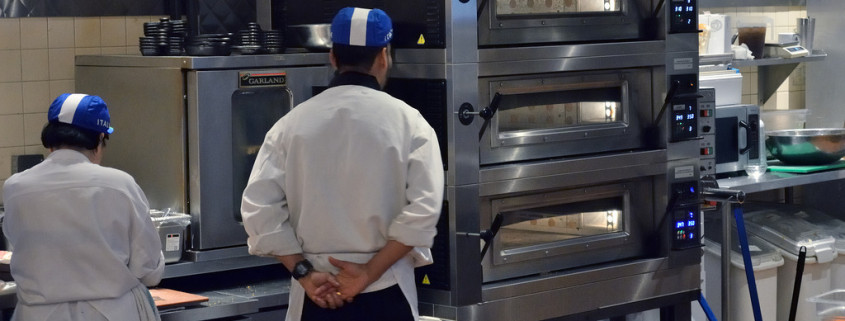 Tagrisk Restaurant Ergonomics Employees Standing in Front of Oven in Kitchen